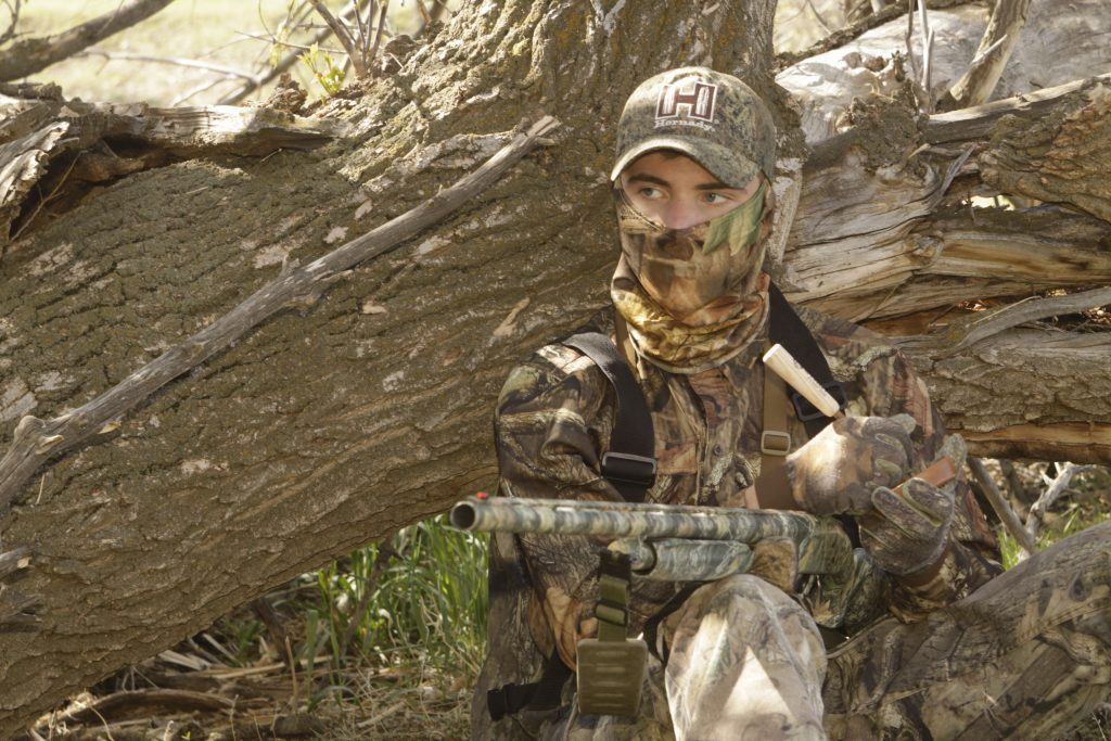 Mark Kayser's son Cole works a tom in the midmorning hours to toss tradition out the window for turkey hunting success.
